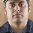 Close up of Hispanic man wearing hard hat — Stock Photo