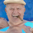 Senior msmoking cigar and sunbathing — Stock Photo #13231167