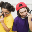 Mixed Race children talking on walkie talkies — Stock Photo