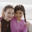 Two girls smiling and hugging — Stock Photo