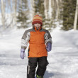 Portrait of boy snowshoeing - Stock Photo