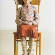 Stock Photo: Portrait of Pacific Islander girl sitting in chair
