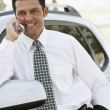 Hispanic businessman talking on cell phone — Stock Photo