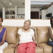 Stock Photo: Portrait of three generations of women sitting on couch
