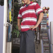 Teenage boy in messy bedroom — Stock Photo #13231280
