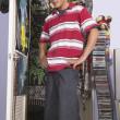 Teenage boy in messy bedroom — Stock Photo #13231280