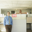 Businessmen smiling for the camera in empty office space — Stock Photo #13231289