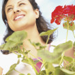 Low angle view of woman holding plant - Foto de Stock