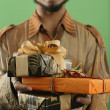 Stock Photo: Mwith wrapped gifts