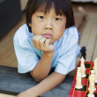 Royalty-Free Stock Photo: Young boy on stairs with chess set