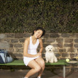 Female tennis player with dog — Stock Photo #13231426