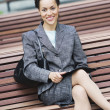 Stock Photo: Businesswomsitting on park bench