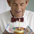 Elderly man celebrating birthday - Stock Photo