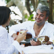South American man playing guitar for wife — Stock Photo