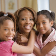 Stock Photo: Mother and daughters smiling for the camera