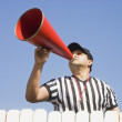 Hispanic referee yelling over fence — Stock Photo