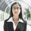 Portrait of businesswoman standing in tunnel — Stock Photo