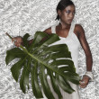 Portrait of African woman holding Monstera leaf — Stock Photo