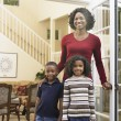 Stock Photo: AfricAmericmother and children in doorway