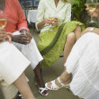 Stock Photo: Young women relaxing together with wine