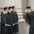 Graduate taking picture of colleagues — Stock Photo