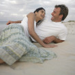 Couple lying on the beach — Stock Photo