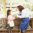 Hispanic woman and girl in pottery shop - Stock Photo