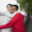 Asian couple hugging outdoors — Stock Photo