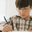Greek boy doing homework — Stock Photo