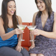 Young women toasting each other with martinis — Stock Photo