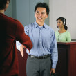 Businesspeople shaking hands in office — Stock Photo