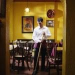 Man mopping restaurant floor — Stock Photo #13231668