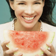 Young woman eating a seedless watermelon — Stock Photo