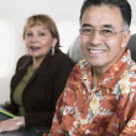 Portrait of couple on airplane — Stock Photo