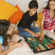 Hispanic family playing board game — Stock Photo
