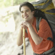 Young man hiking on a trail — Stock Photo