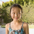 Portrait of Asian girl in bathing suit - Stock Photo