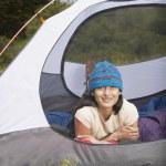 Woman lying down inside tent — Stock Photo #13231760