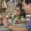Stock Photo: Hispanic father and daughter painting doll house