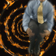 Man jumping out of focus with fire spiral background — Foto de Stock