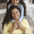 Portrait of mother and daughter smiling - Stock Photo