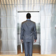 Stock Photo: Businessman waiting for elevator