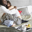Couple hugging in bed — Stock Photo