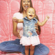 Mother and baby daughter laughing — Stock Photo
