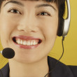 Close up portrait of businesswoman with headset — Stock Photo