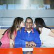 Two teenage girls kissing teenage boy — Stock Photo