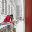 Asian couple looking at map in London — Stock Photo