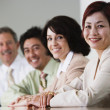 Portrait of businesspeople in conference room — ストック写真
