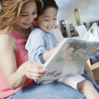 Woman reading to boy - Stockfoto