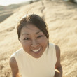 Senior woman smiling for the camera outdoors — Stock Photo